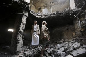 Houthi militants stand in the house of Houthi leader Yahya Aiydh, after Saudi-led air strikes destroyed it in Yemen's capital Sanaa September 8, 2015. REUTERS/Khaled Abdullah