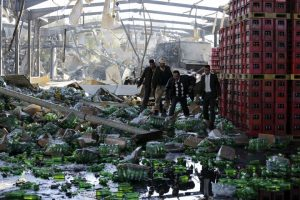 Officials inspect damage at a Coca-Cola beverages factory after Saudi-led air strikes destroyed it in Yemen's capital Sanaa December 30, 2015. REUTERS/Khaled Abdullah